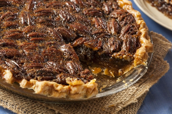 A delicious homemade pecan pie in a glass dish.