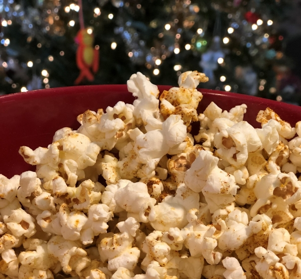 Savory Cajun-Spiced Popcorn in front of a Christmas Tree
