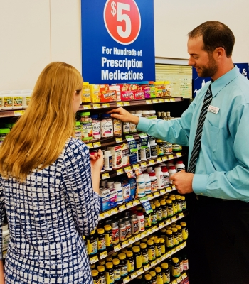 Pharmacist Brady Shimek helping a pharmacy customer