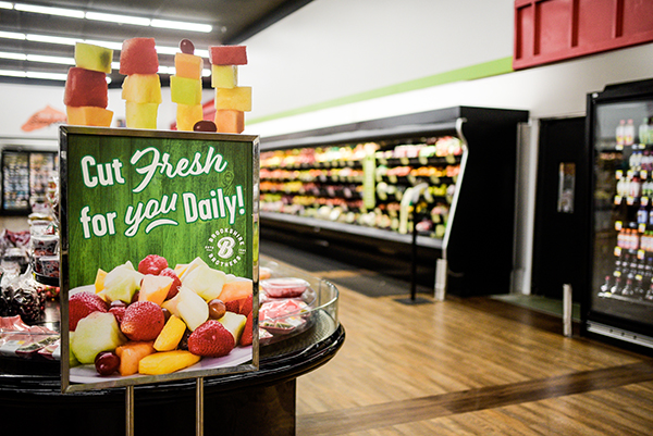 A sign advertising the fresh cut fruit in the newly remodeled Huntsville store
