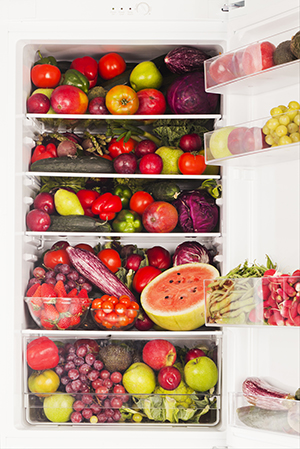 A fridge packed full of fruit.