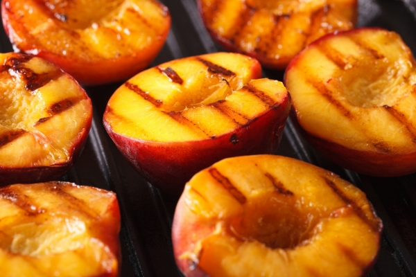 Fresh peaches on a grill.