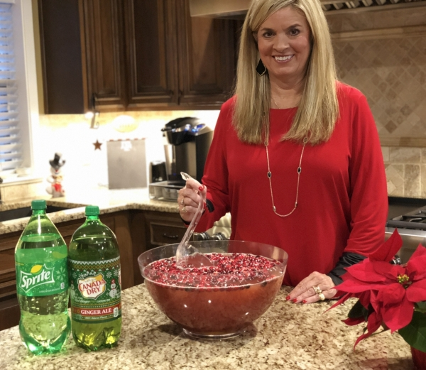 Mrs. Lynne Haney stirring a bowl of her famous holiday punch