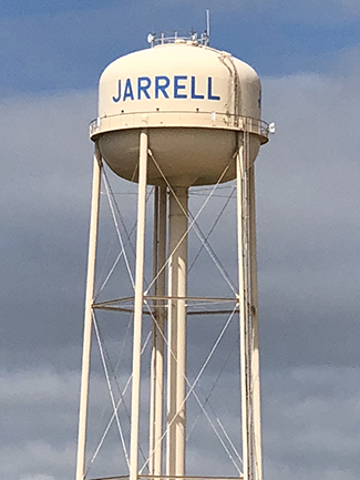 A zoomed in shot of the water tower in Jarrell, Texas