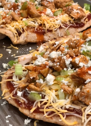 A prepared shot of the Buffalo Chicken & Blue Cheese BBQ Flatbread Pizza before it goes into the oven.