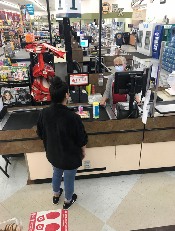 Woman in a face mask at a cash register